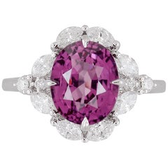 GIA Certified 4.19 Carat Oval Cut Exotic Pink-Purple Garnet and Diamond Ring