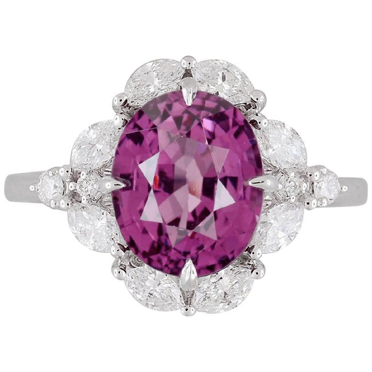 GIA Certified 4.19 Carat Oval Cut Exotic Pink-Purple Garnet and Diamond Ring For Sale