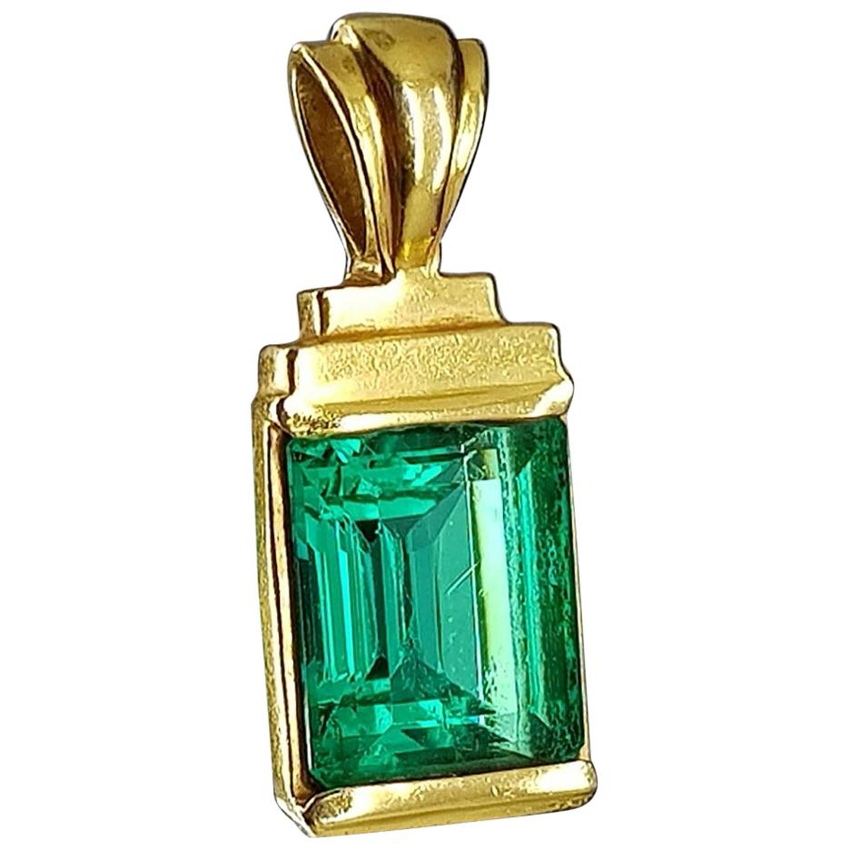 GIA Certified 4.23 Carat Emerald Cut Emerald Set in 18 Karat Yellow Gold
