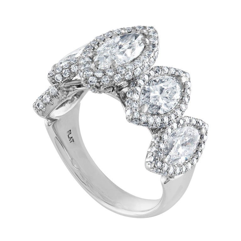 5 stone Marquise Cut Ring The ring is Platinum The ring has a center stone GIA 0.94CT H SI1 The 4 side stones 2.25Ct H VS/SI There are 1.04CT in small round diamonds G/H VS. All Diamonds weigh together 4.23 Carats. The ring is a size 6.75,