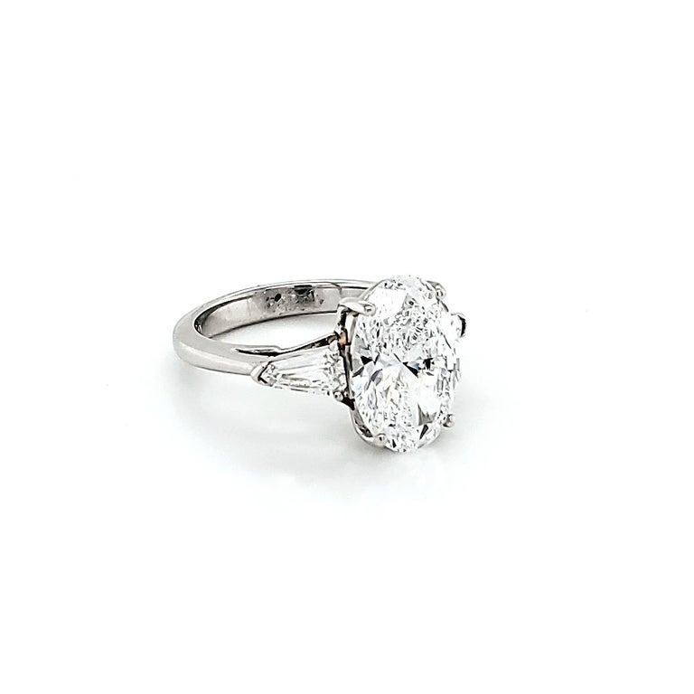 Oval Cut GIA Certified 4.23 Carat Oval Diamond Three-Stone Ring For Sale