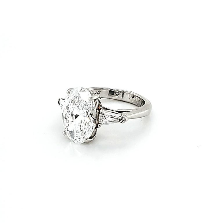 GIA Certified 4.23 Carat Oval Diamond Three-Stone Ring In New Condition For Sale In New York, NY