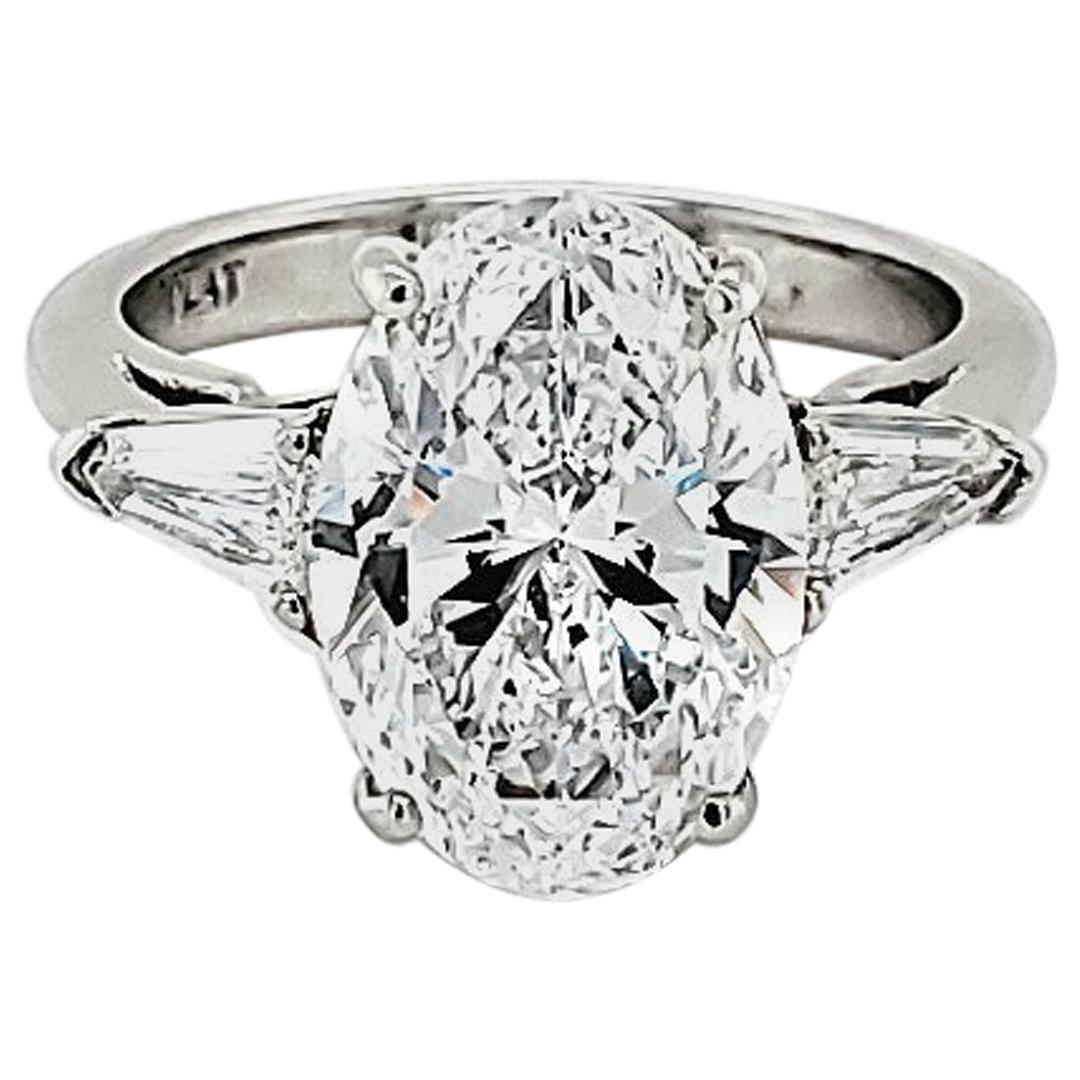GIA Certified 4.23 Carat Oval Diamond Three-Stone Ring