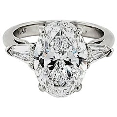 GIA Certified 4.23 Carat Oval Diamond Three-Stone Ring