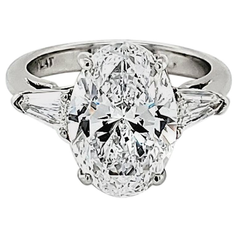 GIA Certified 4.23 Carat Oval Diamond Three-Stone Ring For Sale