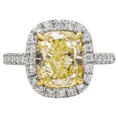 GIA Certified 4.30 Carat Cushion Cut Yellow Diamond Halo Engagement Ring