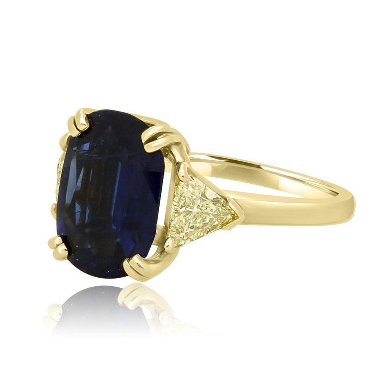 Modern GIA Certified 4.39 Carat Blue Sapphire Cushion Yellow Diamond Three-Stone Ring For Sale