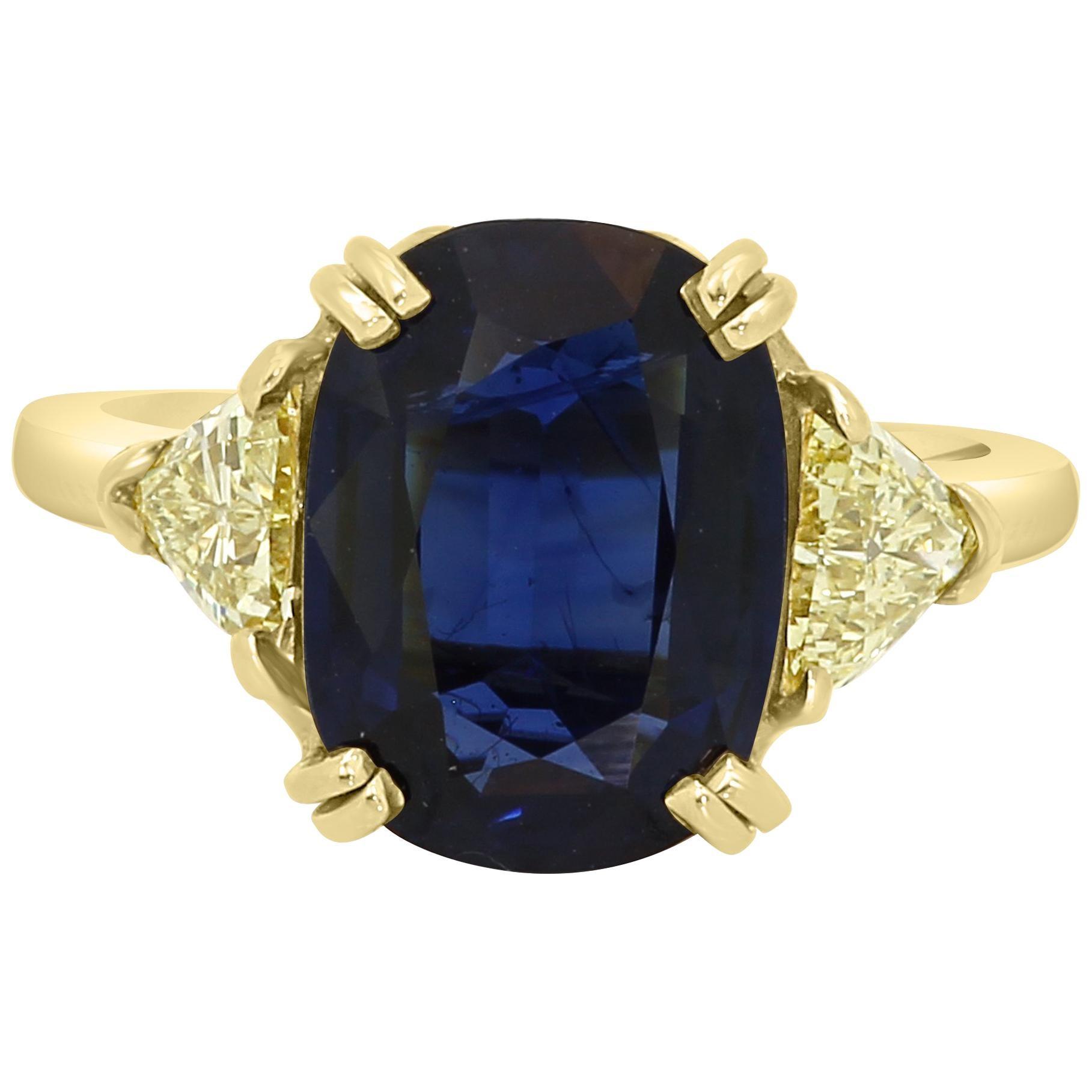GIA Certified 4.39 Carat Blue Sapphire Cushion Yellow Diamond Three-Stone Ring