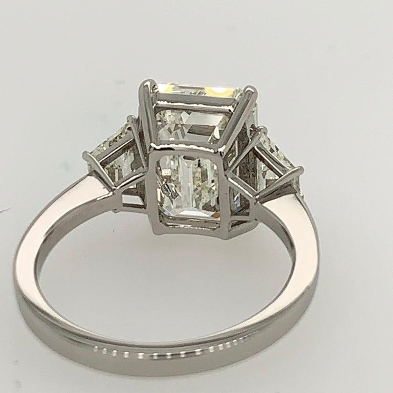 GIA Certified 4.40 Carat Emerald Cut J VS2 Natural Diamond Platinum Ring For Sale 3