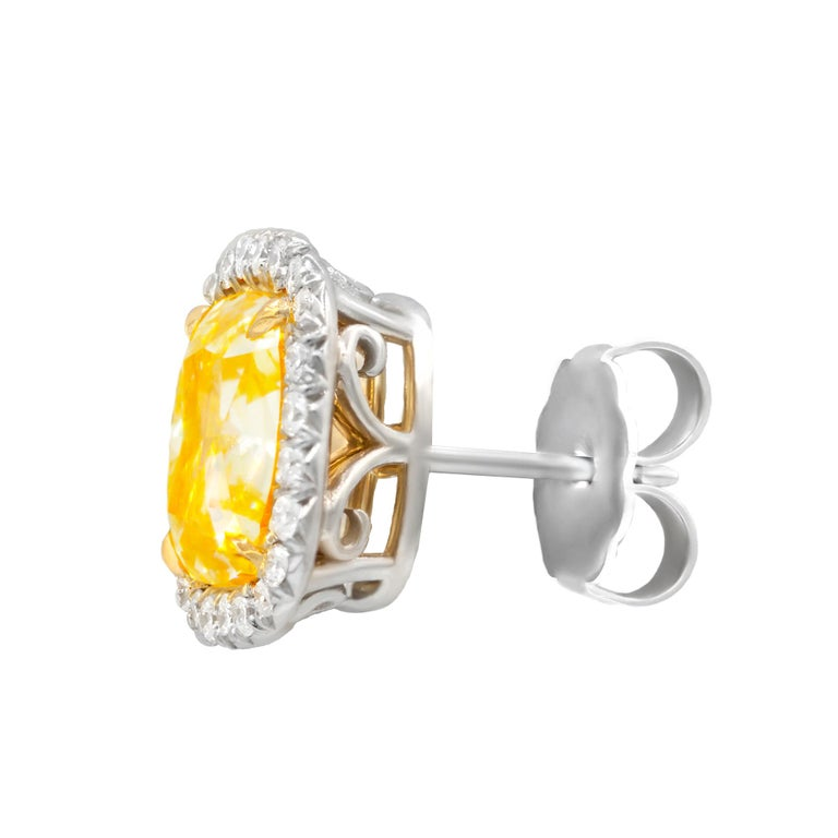 Women's GIA Certified 4.42 Carat Cushion Cut Fancy Yellow Diamond Stud Earrings For Sale