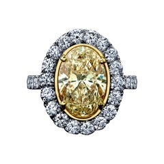 GIA Certified 4.47 Carats Oval Yellow Diamond Ring Plat/18KYG