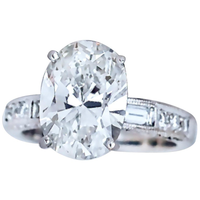 GIA Certified 4.5 Carat Oval H-VS2 Diamond Engagement Ring For Sale