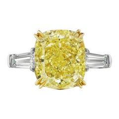 GIA Certified 4.50 Carat Fancy Intense Yellow Cushion Diamond Platinum Ring