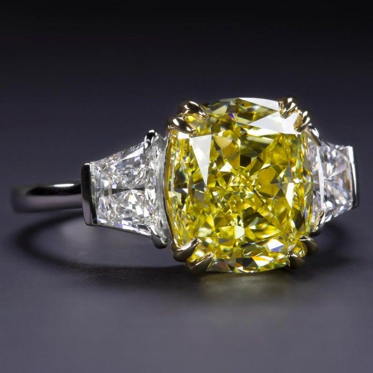 Modern GIA Certified 4.50 Carat Fancy Vivid Yellow Cushion Diamond Platinum Ring For Sale