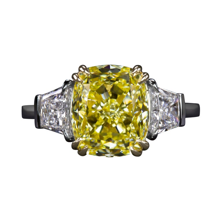GIA Certified 4.50 Carat Fancy Vivid Yellow Cushion Diamond Platinum Ring For Sale