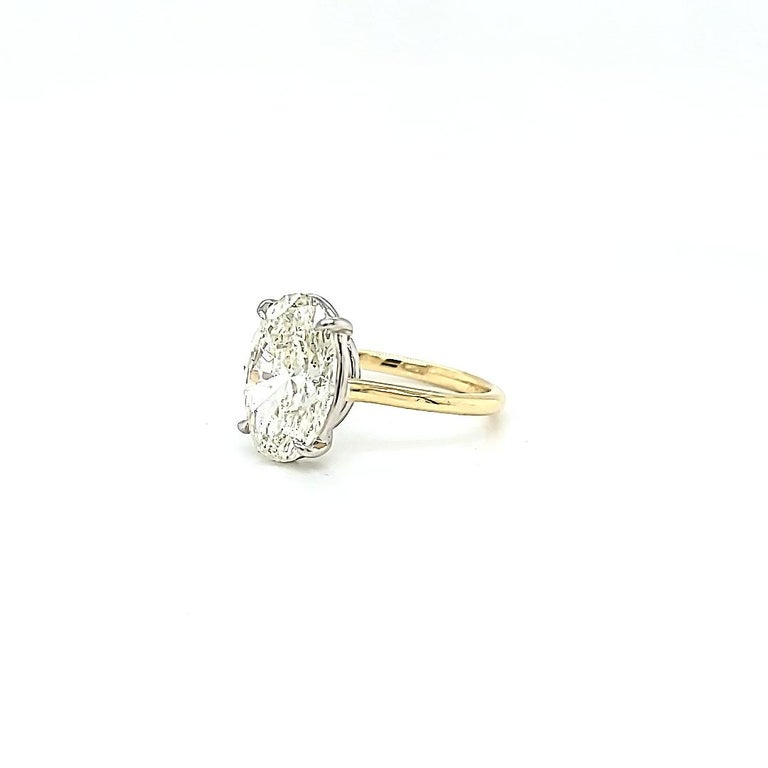 GIA Certified 4.50 Carat Oval Diamond Solitaire Ring In New Condition For Sale In New York, NY