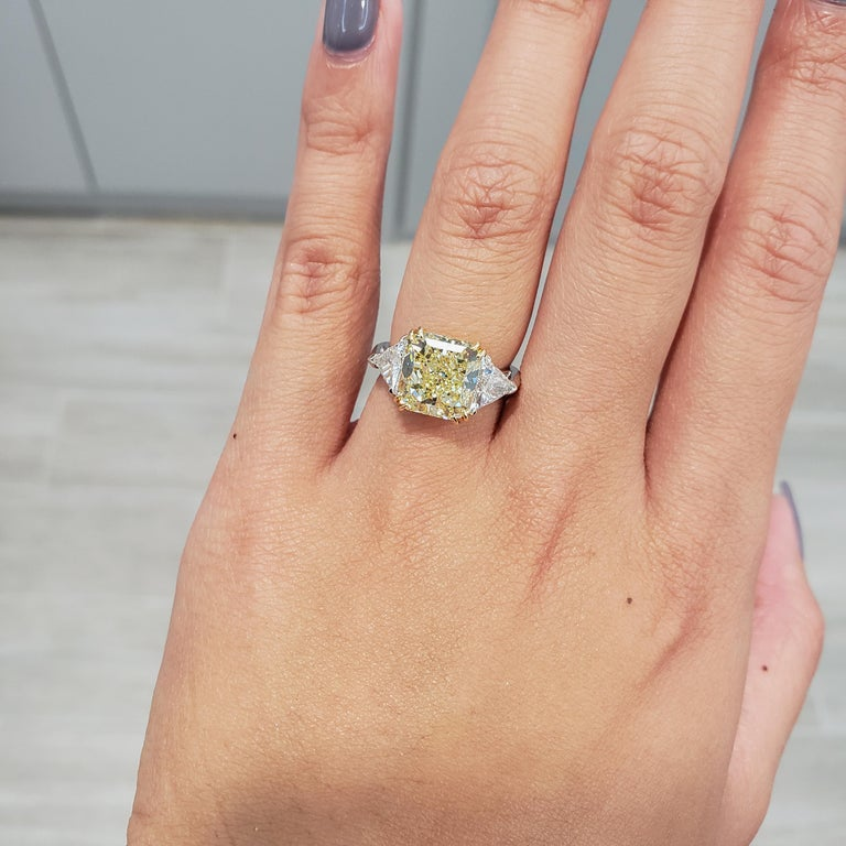 GIA Certified 4.50 Carat Radiant Cut Yellow Diamond Three-Stone Engagement Ring In New Condition For Sale In New York, NY