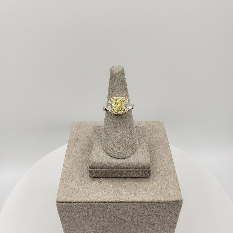 Women's or Men's GIA Certified 4.50 Carat Radiant Cut Yellow Diamond Three-Stone Engagement Ring For Sale
