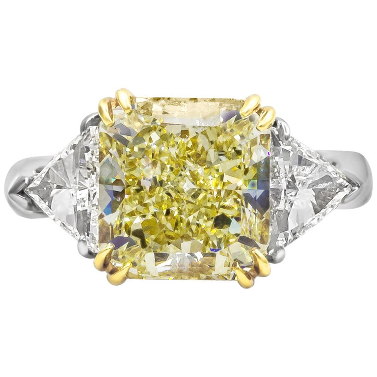 GIA Certified 4.50 Carat Radiant Cut Yellow Diamond Three-Stone Engagement Ring For Sale