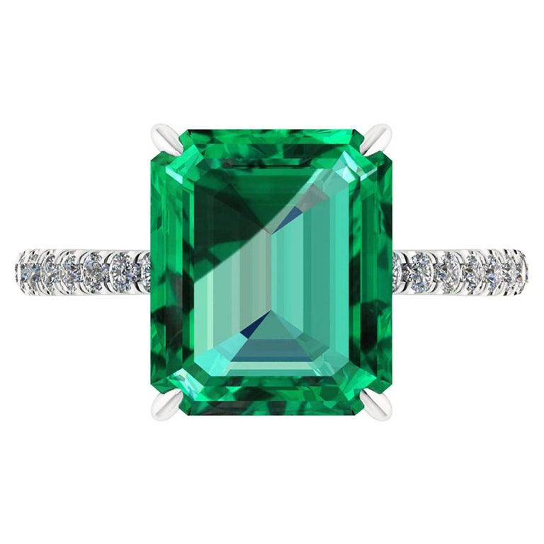 GIA Certified 4.53 Carat Emerald Cut Emerald Diamond Platinum Ring For Sale