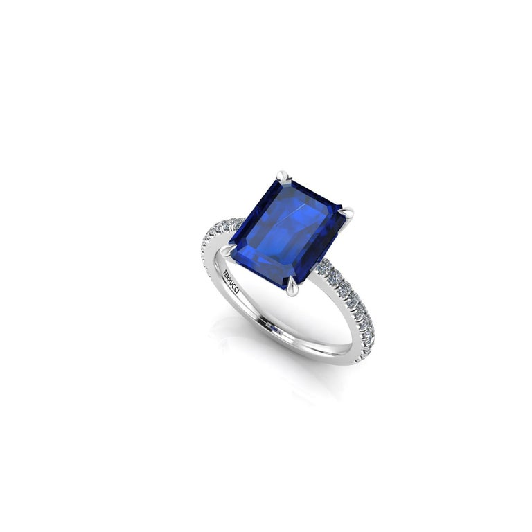 GIA Certified 4.53 carat Sri Lanka emerald cut Sapphire, very high quality color,  embellished by a pave' of bright diamonds of approximately  total carat weight of 0.32 carat, set in a hand crafted Platinum 950 ring, manufactured with the best