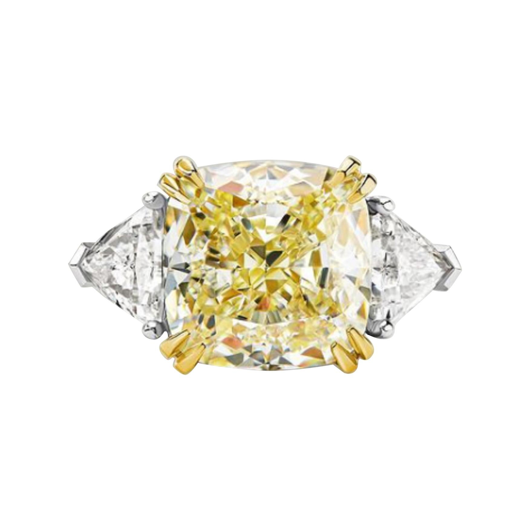GIA Certified 4.65 Carat Fancy Light Yellow Cushion Three Stone Diamond Ring