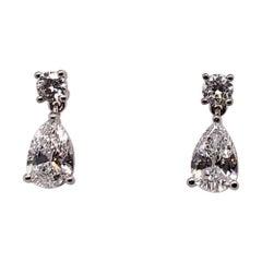 GIA Certified 4.65 Carat Matching Pear Shape E-F VS2 Natural Diamond Earrings