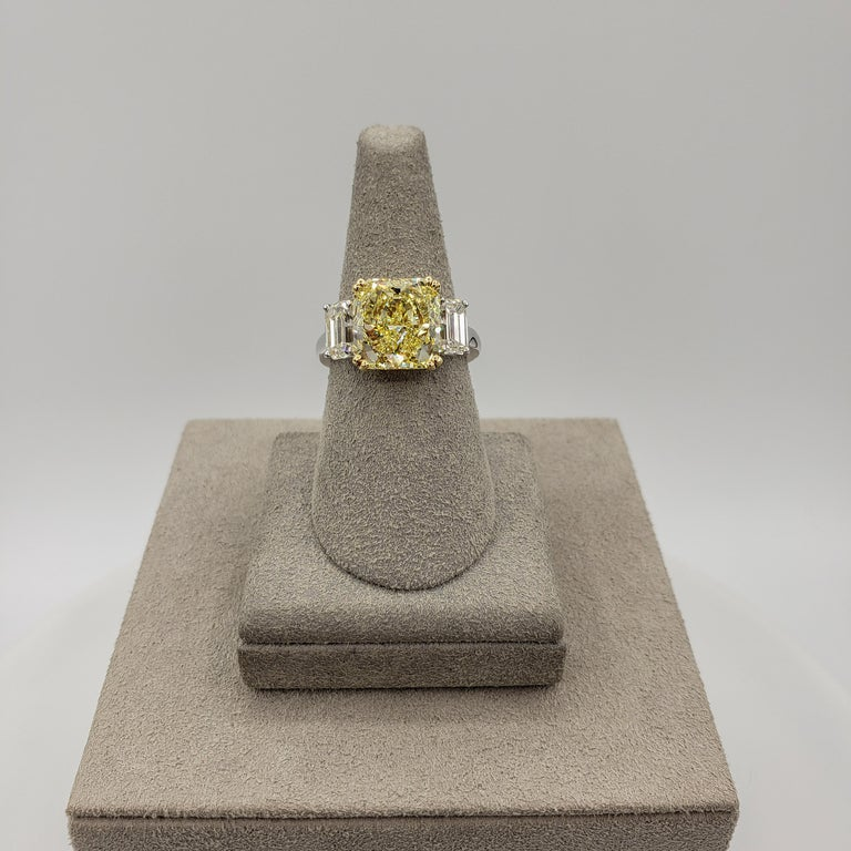 Contemporary GIA Certified 4.68 Carat Intense Yellow Diamond Three-Stone Engagement Ring For Sale