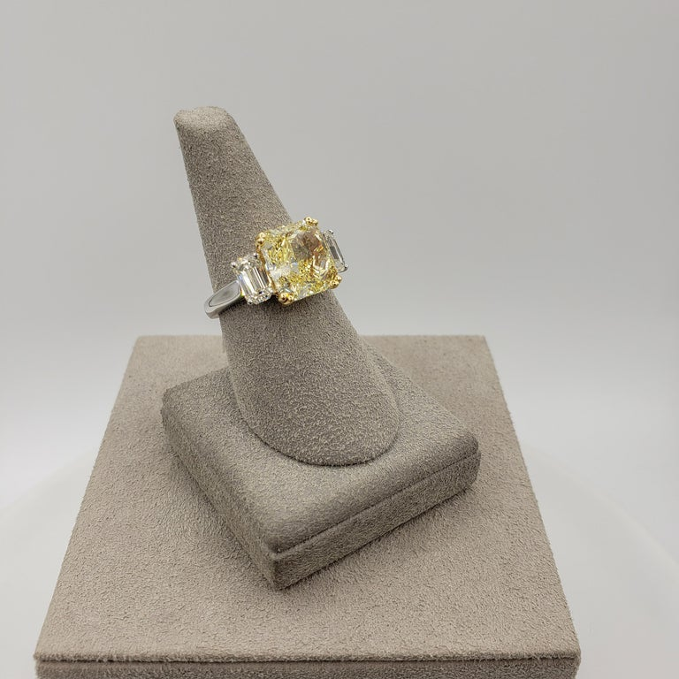 Radiant Cut GIA Certified 4.68 Carat Intense Yellow Diamond Three-Stone Engagement Ring For Sale