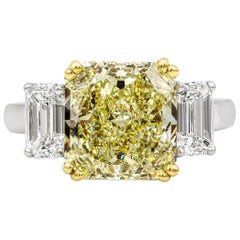 GIA Certified 4.68 Carat Intense Yellow Diamond Three-Stone Engagement Ring