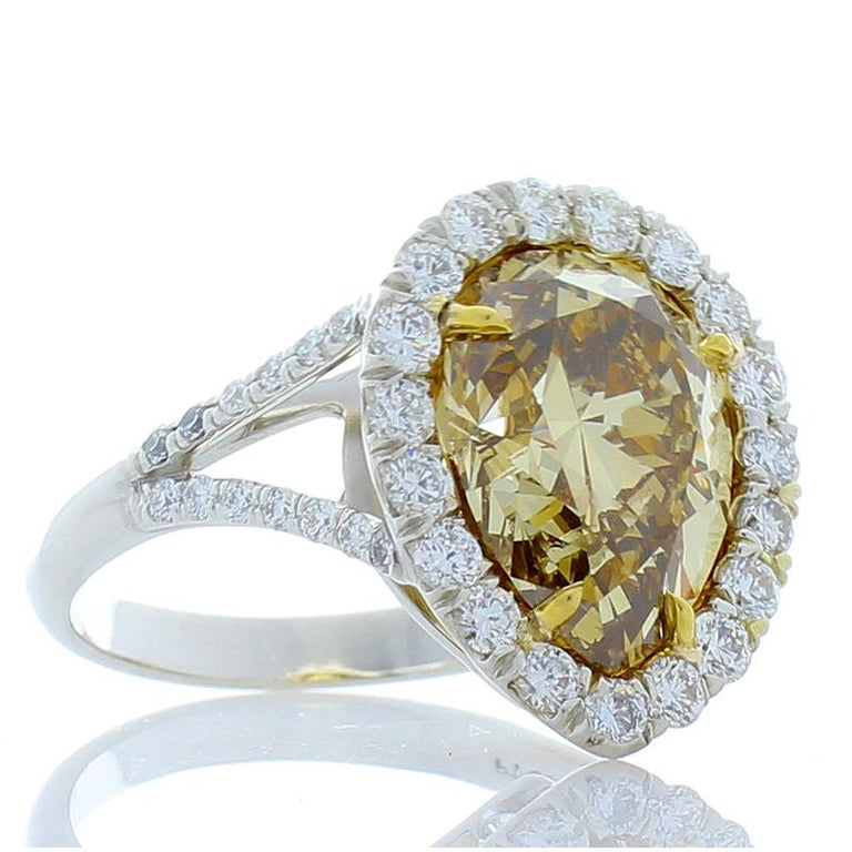 Contemporary GIA Certified 4.68 Carat Pear Shape Fancy Brownish Yellow Diamond Cocktail Ring For Sale