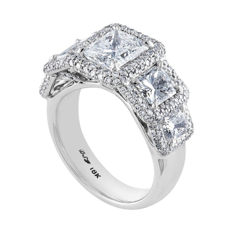 5 stone Radiant Cut Ring The ring is 18K/750 white gold The ring has a center stone GIA 2.01CT E VS2 The side stone is GIA 0.70CT E VS2 The side stone is GIA 0.73CT G VVS2 The smaller 2 Radiants are 0.60CT E VS There are 0.77CT in small round