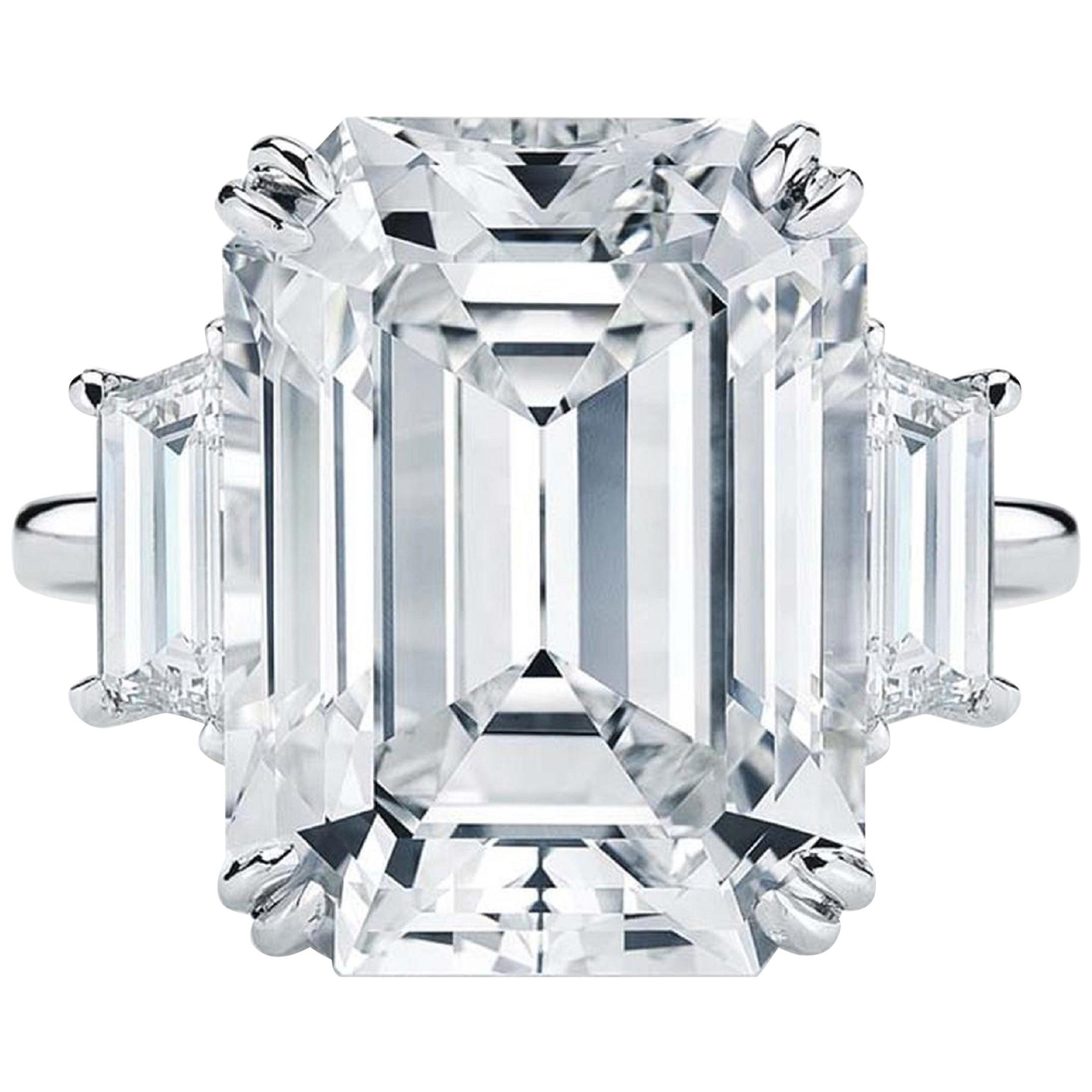 GIA Certified 4 Carat Three-Stone Emerald Cut Trapezoid Platinum Ring