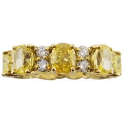 GIA Certified 4.98 Carat Natural Fancy Vivid Yellow Oval Diamond Eternity Band