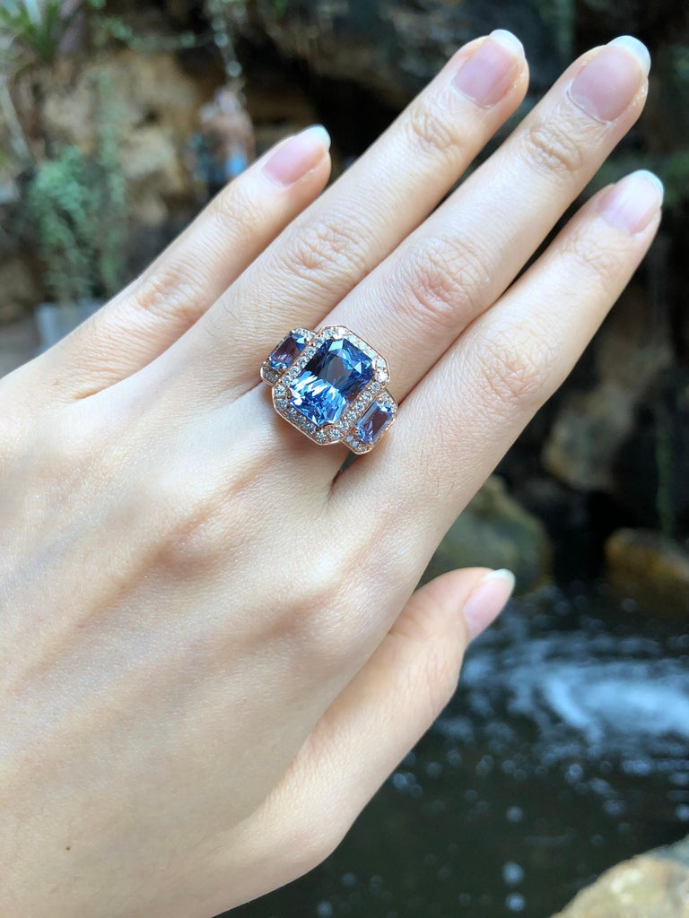 Blue Sapphire 5.42 carats with Blue Sapphire 1.46 carats and Diamond 0.59 carat Ring set in 18 Karat Rose Gold Settings (GIA Certified)   Width:  1.9 cm  Length: 1.5 cm Ring Size: 51 Total Weight: 8.45 grams