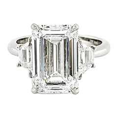 GIA Certified 5.01 Carat Emerald Cut Three-Stone Ring