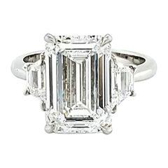 GIA Certified 5.01 Carat Emerald Cut Three-Stone Ring