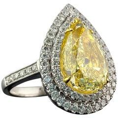 GIA Certified 5.02 Carat Yellow Diamond Engagement Ring