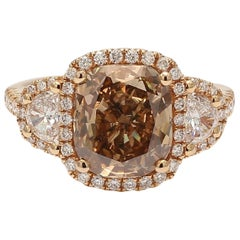 GIA Certified 5.04 Carat Fancy Orange-Brown Cushion Cut Diamond Three-Stone Ring