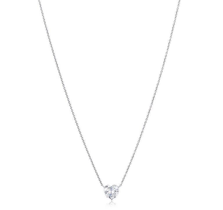 Exquisite diamond heart shape pendant necklace. This dazzling heart shape diamond weighing 5.04 carat is graded by the GIA K in color SI2 clarity. This diamond Is special and unique for being perfectly cut with an exceptional flow of translucency