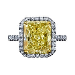 EGL Certified 5.04ct Radiant Fancy Yellow Diamond Ring