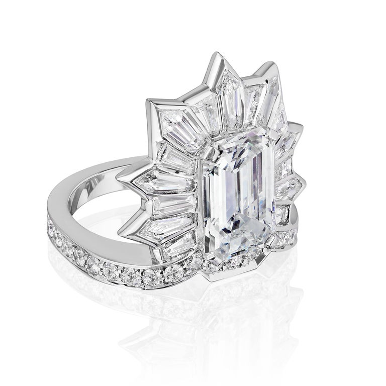 Highly unusual Emerald Cut Diamond Cocktail Ring.  Emerald Cut center stone weighing 5.20 Carats surrounded by Kite and Baguette shaped Diamonds weighing 2.25 Carats with Round Brilliant Diamonds weighing 0.60 Carats. Emerald cut is GIA certified as
