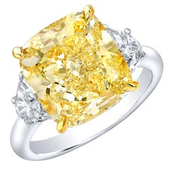 GIA Certified 5.20 Carat Fancy Yellow SI1 Cushion Diamond Three-Stone Ring