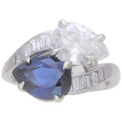 GIA Certified 5.28 Carat Corundum Sapphire and Antique Pear Diamond Bypass Ring