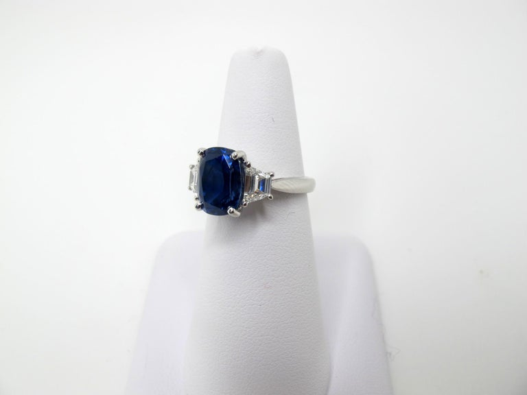 A rich, medium blue, gem quality sapphire that weighs 5.28 carats is featured in this ring. It is accompanied by Gemological Institute of America certificate #2151344955 which states that it is unheated and comes from Sri Lanka. The sapphire is