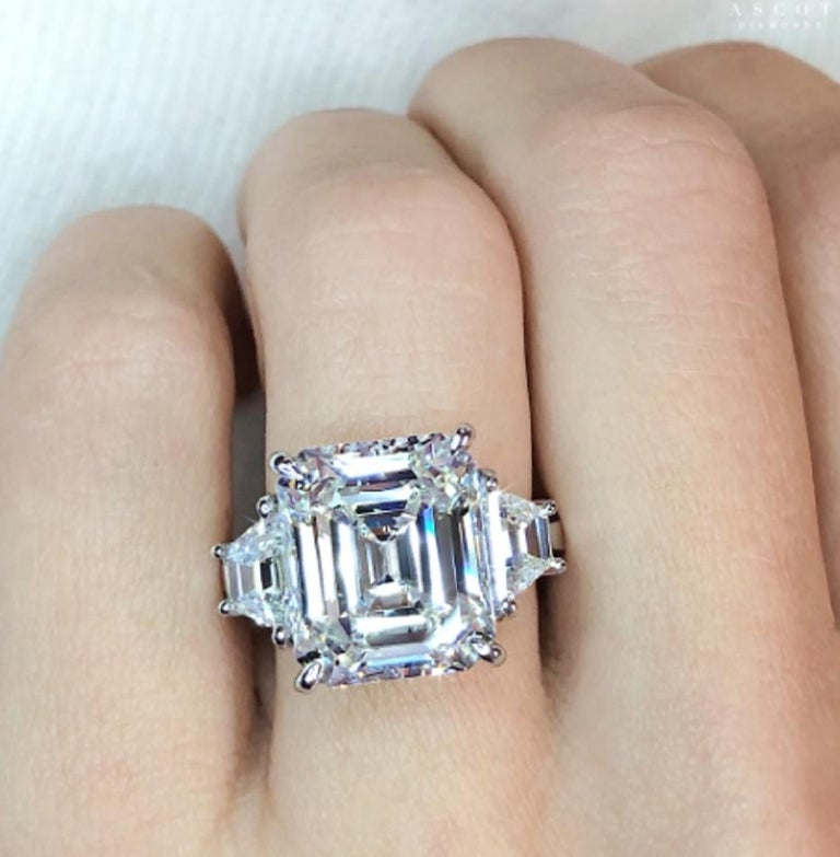 Diamond engagement ring, centering a fine g color and vvs2 clarity asscher-cut diamond weighing 5 carats with a pair of tapered baguette-cut diamond shoulders, mounted in platinum.