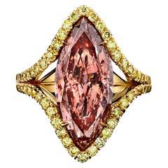 GIA Certified 5.43 Carat Marquise Cut Fancy Intense Orangy Pink Diamond Ring
