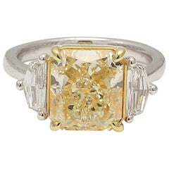 GIA Certified 5.46 Carat Yellow Radiant Three-Stone Platinum Ring