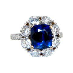 GIA Certified 5.48 Carat Natural No Heat Royal Blue Sapphire Ring Halo Prime