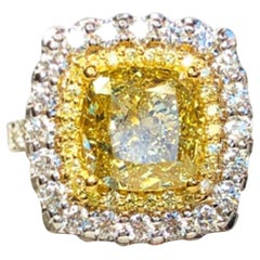 GIA Certified 4.11 Carat Fancy Intense Yellow White Diamond Halo Ring VS2